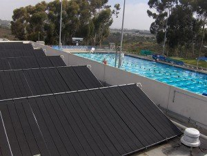large Heliocol solar pool heating installation saves money while keeping the outdoor pool at UC San Diego warm and comfortable.