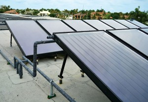 An impressive array of Aurora Solene by AET solar water heating collectors at the exclusive Admiral's Cove yacht club in Florida.